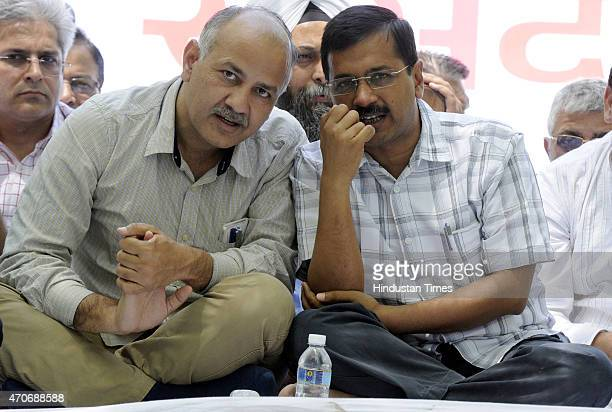 Delhi Chief Minister Arvind Kejriwal talks with Delhi Deputy Chief Minister Manish Sisodia during rally against the controversial land ordinance at...