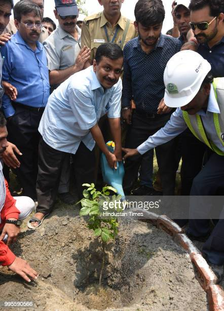 Delhi chief minister Arvind Kejriwal waters a tree during his visit to Coronation Sewage Treatment Plant at Burari on July 10 2018 in New Delhi India...