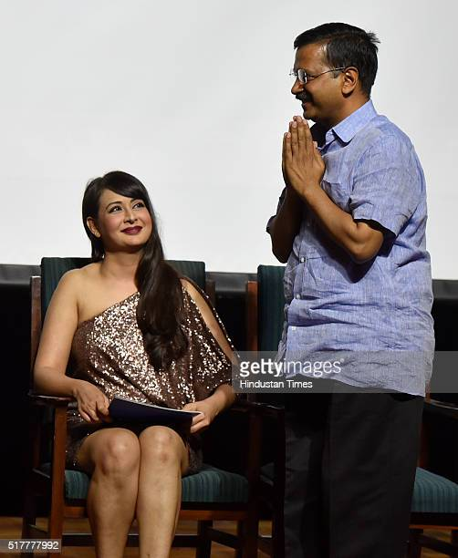 Delhi Chief Minister Arvind Kejriwal with Bollywood actor Preeti Jhangiani during the Sindhi film festival at Teen Murti on March 27 2016 in New...