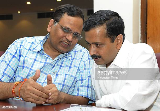 Delhi Chief Minister Arvind Kejriwal with Delhi Health Minister Satyendra Jain before their meeting with Urban Development Minister M Venkaiah Naidu...