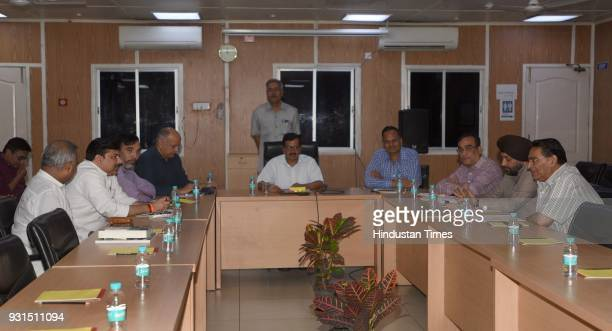 Delhi Chief Minister Arvind Kejriwal with DPCC President Ajay Maken former Education Minister Arvinder Singh Lovely former DPCC president Subhash...