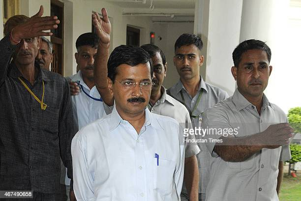 Delhi Chief Minister Arvind Kejriwal with his security persons arrives at assembly hall for the attending the Delhi Assembly session at Delhi Vidhan...