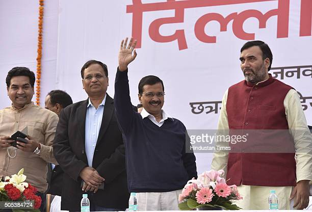 Delhi Chief Minister Arvind Kejriwal with Transport Minister Gopal Rai at a thanksgiving rally following the success of his government's oddeven...