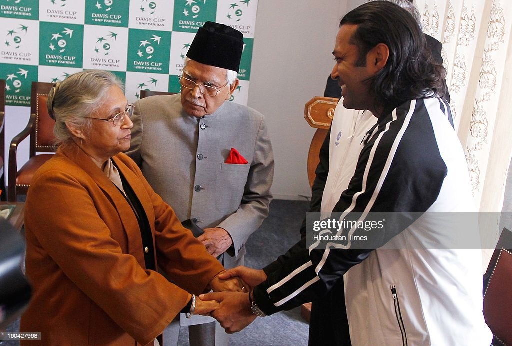 Delhi Chief Minister Sheila Dikshit shares a laugh with tennis player Leander Paes during the draw for Davis Cup Asia/Oceania Group I at Delhi Lawn Tennis Association (DLTA) tennis court on January 31, 2013 in New Delhi, India.