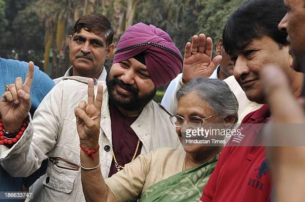 Delhi Chief Minister Sheila Dikshit with Punjabi pop singer Daler Mehndi Delhi Power Minister Haroon Yusuf pose for the photographers during the...