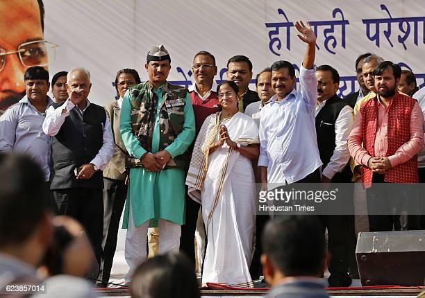 Delhi CM Arvind Kejriwal along with West Bengal CM Mamata Banerjee during Jansamvad rally organized by Traders Association at Azadpur Mandi on...