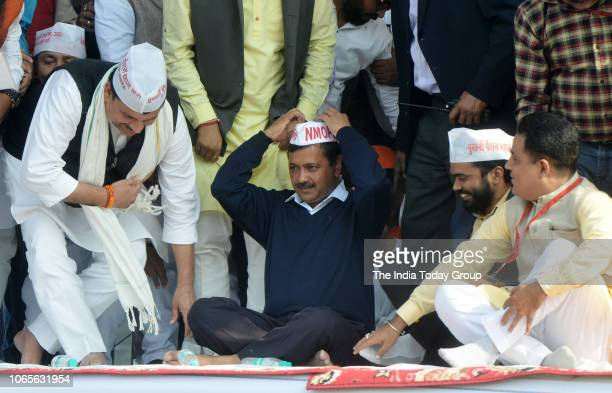 Delhi CM Arvind Kejriwal and AAP senior leader Sanjay Singh during the protest against National Pensioners Scheme at Ramlila Maidan in New Delhi