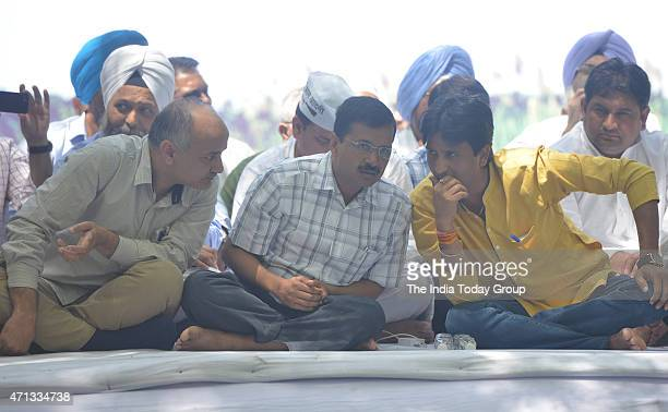 Delhi CM Arvind Kejriwal with his deputy Manish Sisodia and party leader Kumar Vishwas during Aam Aadmi Party rally against the Union government Land...