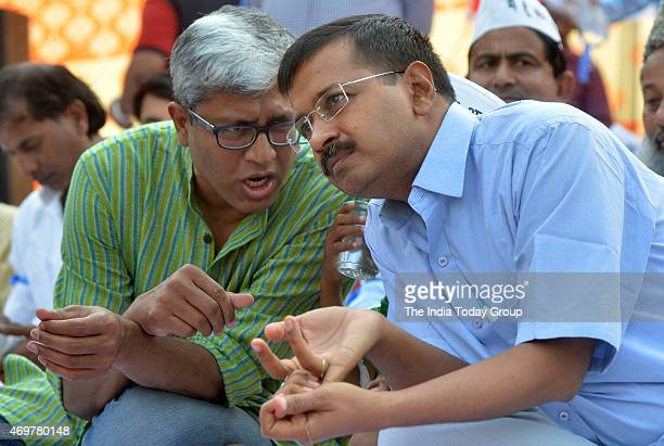 Delhi CM Arvind Kejriwal with Party Leader Ashutosh during a rally in East Delhi
