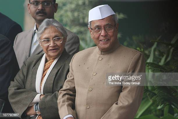 Delhi CM Sheila Dikshit and finance minister Pranab Mukherjee attend the AICC Foundation Day at AICC HQ in New Delhi on Tuesday December 28 2010