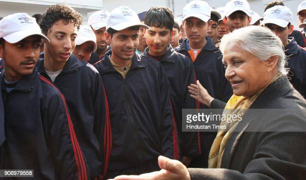 Delhi CM Sheila Dikshit with school children from the remote area of Jammu Kashmir at her residence in New Delhi on Saturday