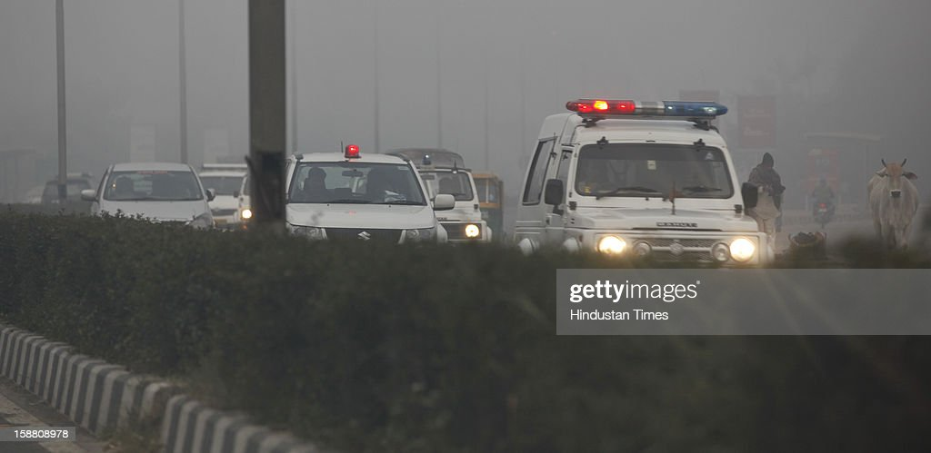 Delhi CM Sheila Dikshit's convoy return after cremation of Gang rape victim after her body arrived from Singapore on December 30, 2012 in New Delhi, India. The 23 year girl died on Saturday at hospital in Singapore, trigging nationwide public outrage. She was gang raped in moving bus on the night of December 16, 2012 in Delhi.