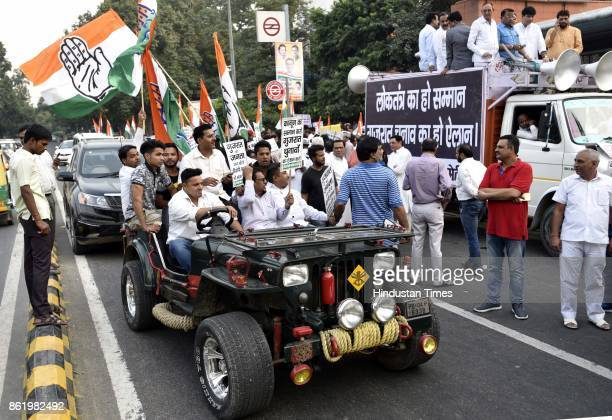 Delhi Congress Chief Ajay Maken with party workers protests against Election Commission for not announcing the dates of Gujarat Assembly elections at...
