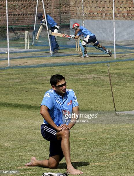 Delhi Daredevil fast bowler Ajit Agarkar strecthing during a practice session at Sehwag International School ground in Jhajjar Haryana on March 29...
