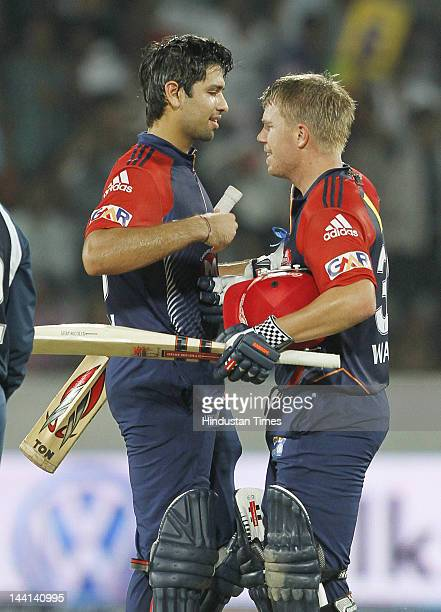 Delhi Daredevil player David Warner congrutulated by teammates Naman Ojha after scoring a century during IPL T20 match played between Deccan Chargers...