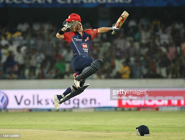 Delhi Daredevil player David Warner jumps in air in jubilation after scoring a century during IPL T20 match played between Deccan Chargers and Delhi...