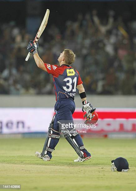 Delhi Daredevil player David Warner raises his bat in air after scoring a century during IPL T20 match played between Deccan Chargers and Delhi...