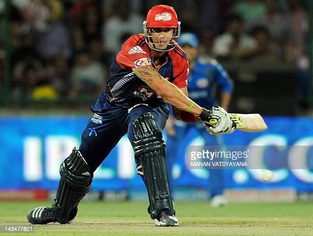 Delhi Daredevils batsman Kevin Pietersen plays a reverse-sweep shot during the IPL Twenty20 cricket match between Delhi Daredevils and Mumbai Indians...