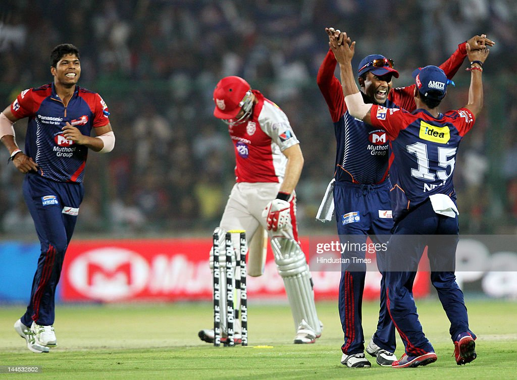 Delhi Daredevils bowler Pawan Negi congratulated by teammate Mahela Jayawardene after he run out the Punjab kings XI David Miller during the IPL cricket match between Delhi Daredevils and Punjab Kings XI, at Ferozshah Kotla Ground on May 15, 2012 in New Delhi, India.