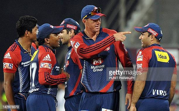 Delhi Daredevils captain Virender Sehwag celebrates with team mates Kevin Pietersen Mahela Jayawardene and others after the wicket of Mumbai Indians...