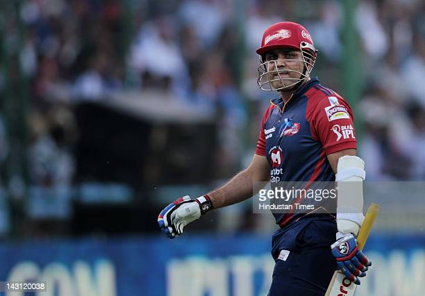 Delhi Daredevils captain Virender Sehwag leaves the ground after getting out during IPL 5 T20 cricket match played between Delhi Daredevils Vs Deccan...