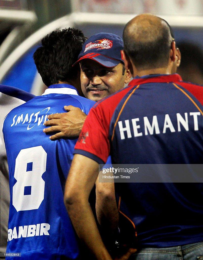 Delhi Daredevils Captain Virendra Sehwag hugs actor Ranbir Kapoor before the IPL cricket match between Delhi Daredevils and Punjab Kings XI, at Ferozshah Kotla Ground on May 15, 2012 in New Delhi, India.