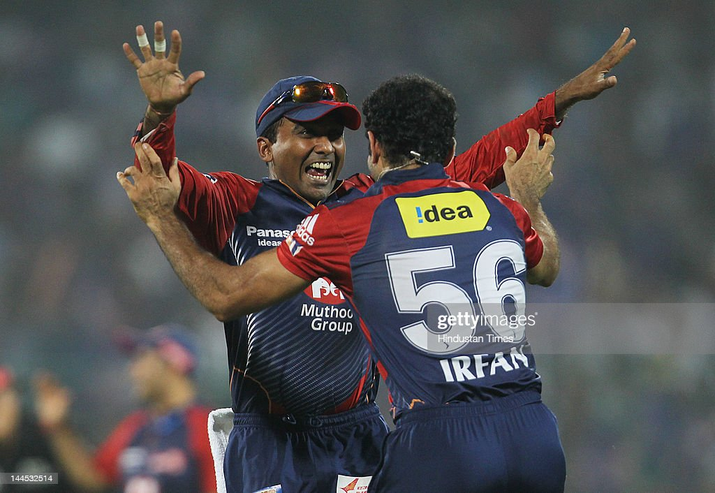 Delhi Daredevils player Irfan Pathan congratulated by teammate Mahela Jayawardene after he took the catch of Kings XI Punjab batsman Azhhar Mahmood during the IPL cricket match between Delhi Daredevils and Punjab Kings XI, at Ferozshah Kotla Ground on May 15, 2012 in New Delhi, India.