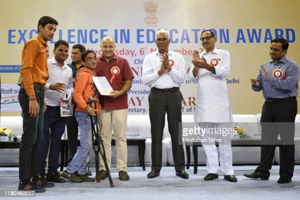 Delhi Deputy Chief Minister and Education Minister Manish Sisodia felicitates a students, during the Excellence in Education Awards 2019, at...