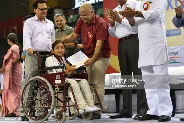 Delhi Deputy Chief Minister and Education Minister Manish Sisodia felicitates a student during the Excellence in Education Awards 2019, at Thyagaraj...