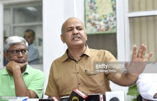 Delhi Deputy Chief Minister Manish Sisodia with AAP Leaders Sanjay Singh and Ashutosh during press conference at Sisodia's residence at Mathura Road...