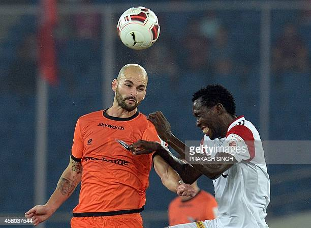 Delhi Dynamocs FC player Hans Mulder plays aganist NorthEast United FC player Kandwani Mtonga during their Indian Super League football match in New...
