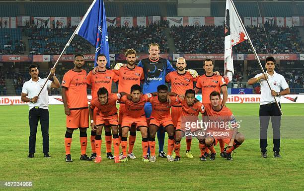 Delhi Dynamocs FC players pose for a group photograph ahead of their Indian Super League football match aganist Pune City FC in New Delhi on October...