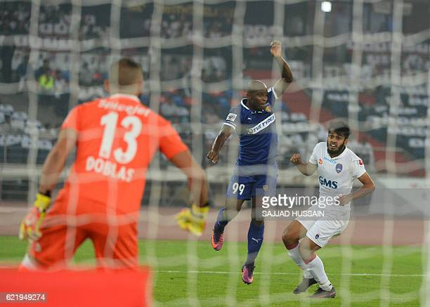 Delhi Dynamos FC defender Souvik Chakrabarti vies for the ball with Chennaiyin FC forward Dudu Omagbemi during the Indian Super League football match...