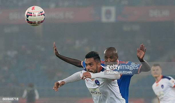 Delhi Dynamos FC forward Robin Singh heads the ball past FC Goa's Brazilian forward Reinaldo Cruz Oliveria during the first leg of the semifinal...