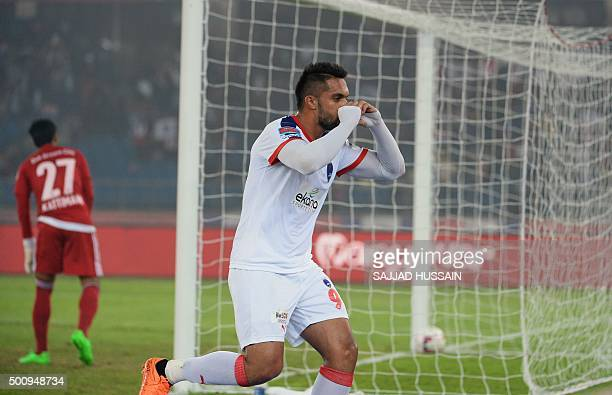 Delhi Dynamos FC forward Robin Singh reacts after scoring during the first leg of the semifinal football match between Delhi Dynamos FC and FC Goa of...