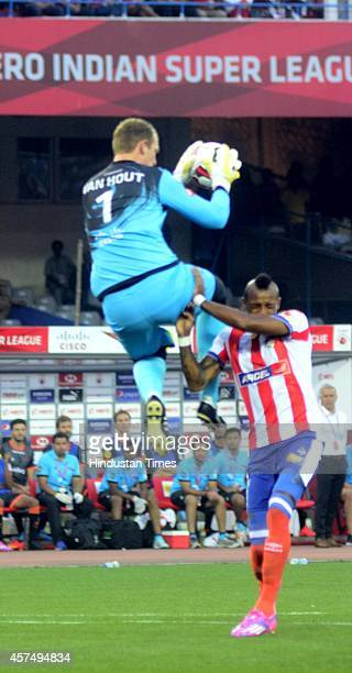 Delhi Dynamos FC goalkeeper Van Hout making a save against Atletico de Kolkata footballer Fikru Lemessa during the Indian Super League football match...