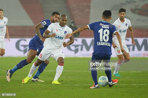 Delhi Dynamos FC midfielder Florent johan Malouda vies for the ball with Chennaiyin FC midfielder Siam Hanghal during the Indian Super League...