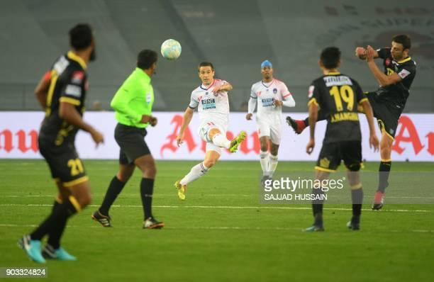 Delhi Dynamos FC player Eduardo Moya Cantillo vies for the ball against Kerala Blaster players during the Hero ISL football match at the Jawahir Lal...