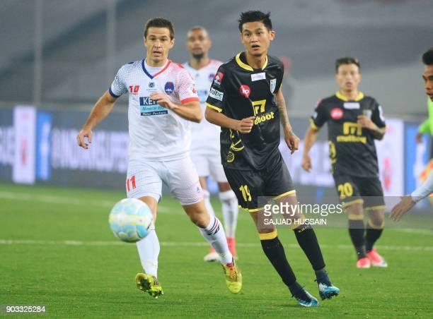 Delhi Dynamos FC player Eduardo Moya Cantillo vies for the ball with Kerala Blaster player Siam Hanghal during the Hero ISL football match at the...