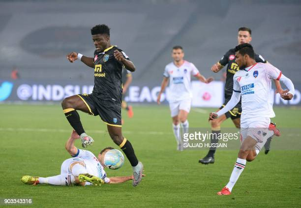 Delhi Dynamos FC player Eduardo Moya Cantillo vies for the ball with with Kerala Blaster player Courage Pekuson during the Hero ISL football match at...