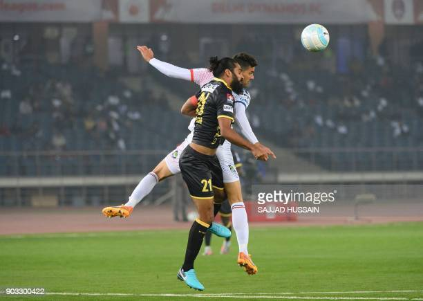 Delhi Dynamos FC player Gabriel Alejandro vies for the ball with Kerala Blaster player Sandesh Jhingan during the Hero ISL football match at the...