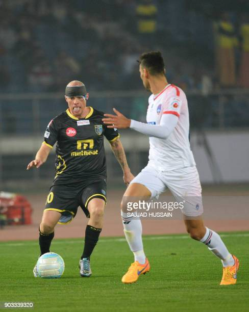 Delhi Dynamos FC player Gabriel Alejandro vies for the ball with with Kerala Blaster player Ian Edward Hume during the Hero ISL football match at the...