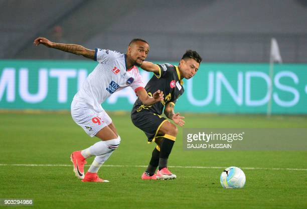Delhi Dynamos FC player Jeron Lombe Lumu vies for the ball with Kerala Blaster player Jackichand Singh during the Hero ISL football match at the...