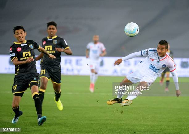 Delhi Dynamos FC player Lallianzuala Chhangte vies for the ball with Kerala Blaster players during the Hero ISL football match at the Jawahir Lal...