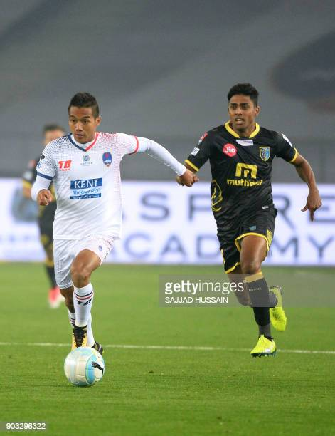 Delhi Dynamos FC player Lallianzuala Chhangte vies for the ball with Kerala Blaster player Rino Anto during the Hero ISL football match at the...