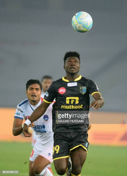 Delhi Dynamos FC player Pritam Kotal vies for the ball with with Kerala Blaster player Courage Pekuson during the Hero ISL football match at the...