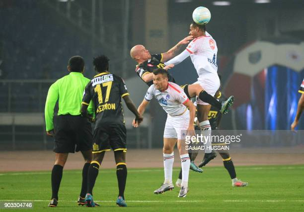 Delhi Dynamos FC players vie for the ball with Kerala Blaster players during the Hero ISL football match at the Jawahir Lal Nehru Stadium in New...
