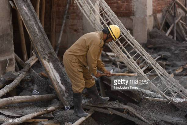 Delhi Fire Service personnel during a rescue operation after a portion of an underconstruction building collapsed in Swaroop Nagar on October 1 2018...