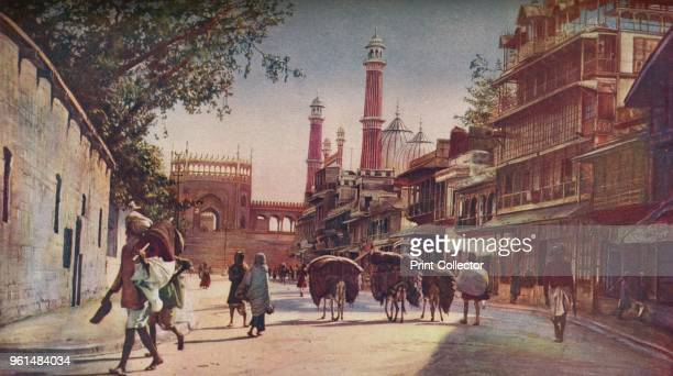 Delhi. In this vista of the Jama Masjid over the backs of the hugely laden donkeys we see the grand flight of steps leading to one of its three...