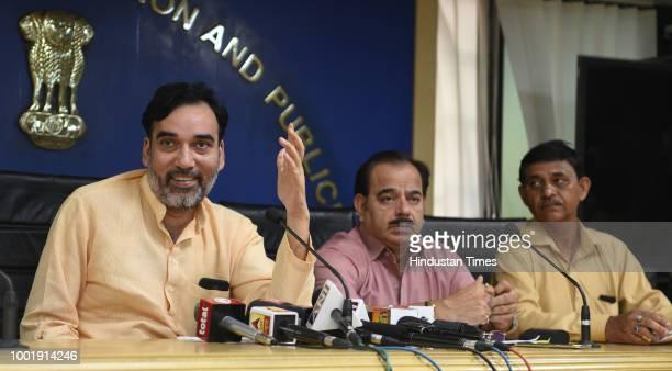 Delhi Labour Minister Gopal Rai speaks to media personeel during a press conferance as additional labour commissioner of Delhi Rajender Dhar looks on...